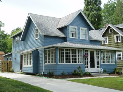 a blue house with a front yard